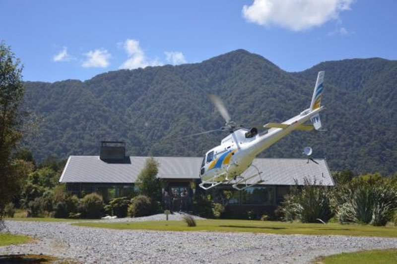 Helicopter landing at Martins Bay Lodge