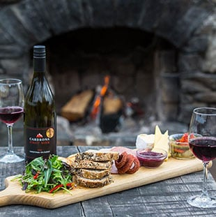 Cheeseboard and New Zealand wine served on luxury tour