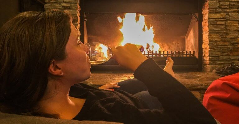 Drink in front of the fire at Lake Ohau, Otago New Zealand