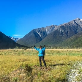 Happy hiker at Travers river, Tasman New Zealand