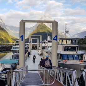 Taking boat at Milford Sound, Fiordland New Zealand