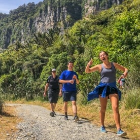 Happy hikers at Porarari river, Paparoa National Park West Coast New Zealand