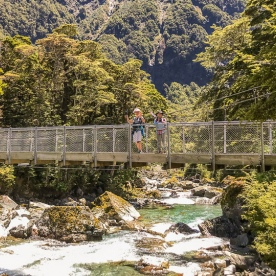 Ladies on the bridge at Routeburn track, Otago New Zealand