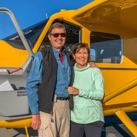Couple with the plane at Mount Aspiring National Park, Otago New Zealand