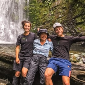 Group at Hollyford track falls, Fiordland New Zealand