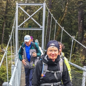 Walking on the bridge at the Routeburn track, Otago New Zealand