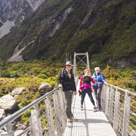 Group on the bridge at Hooker Valley Track, Canterbury New Zealand