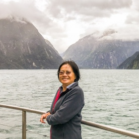 Lady on the boat at Milford Sound, Fiordland New Zealand