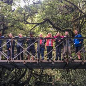 Group on Milford Track Bridge, Fiordland National Park Southland New Zealand