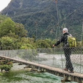Passing on Hollyford Track bridge, Fiordland National Park Southland New Zealand