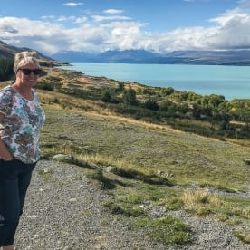 Lady at Lake Pukaki with Aoraki Mount Cook in the background, Canterbury New Zealand