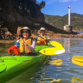 Couple kayaking the Marlborough Sounds, New Zealand