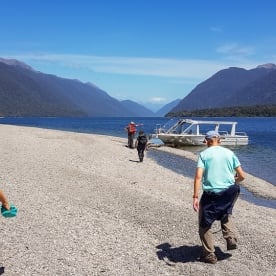 Boarding on jetboat at Hollyford river, Fiordland New Zealand