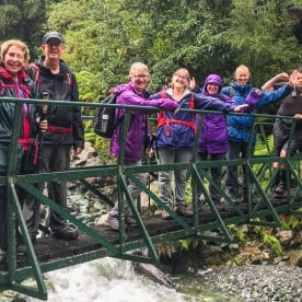 Group on the bridge at Hollyford Track, Fiordland National Park Southland New Zealand