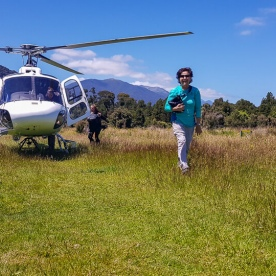 Helicopter landing at Martins Bay, Fiordland New Zealand