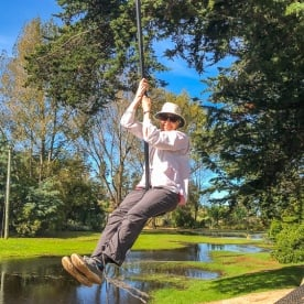 Having fun with the zipline at Waikuku Beach Holiday Park, Canterbury New Zealand