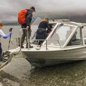 Boarding on the jetboat at Hollyford river, Fiordland New Zealand