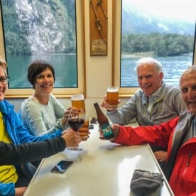 Drink in the boat in Milford Sound, Fiordland New Zealand