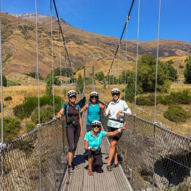 Biking group on the bridge at the Queenstown Trail, Otago New Zealand