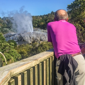 Watching Pohutu Geyser at Rotorua, Bay of Plenty New Zealand