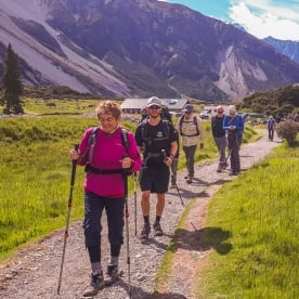 Group walking the Hooker Valley Track, Canterbury New Zealand