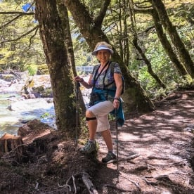 Lady at Routeburn track river, Otago New Zealand