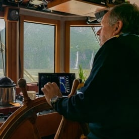 Captain on the boat at Milford Sound, Fiordland New Zealand