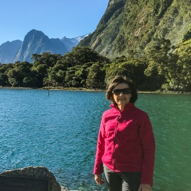 Lady at Milford Sound, Fiordland National Park Southland New Zealand