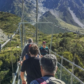 Walking the Hooker Valley Track Bridge, Canterbury New Zealand