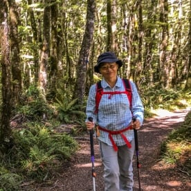 Lady walking at Routeburn track, Otago New Zealand