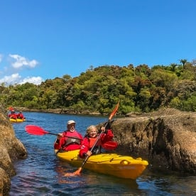 Couple kayaking on lake Taupo, Waikato New Zealand