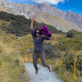 Guest jumping at Tasman Glacier Viewpoint, Canterbury New Zealand