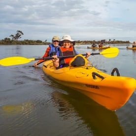 Couple kayaking the Okarito Lagoon, West Coast New Zealand