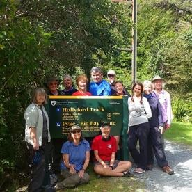 walking group on the hollyford track new zealand