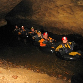 Our team had their own lights in the darkness too! Tubing in the underground river.