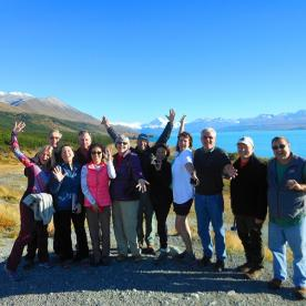 Our team posing for a group shot at Lake Pukaki with Aoraki Mount Cook in the background