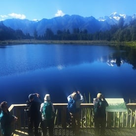 enjoying the reflections at lake matheson new zealand