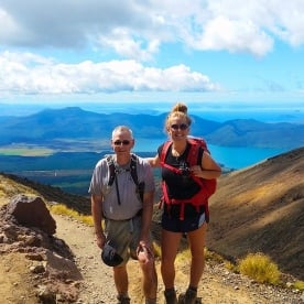 Our super guide Grace with Tom at Tongariro National Park Alpine Crossing. Lake Taupo in the distance