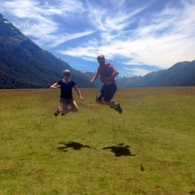 couple jumping in the eglington valley