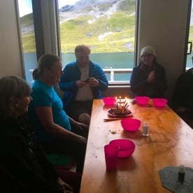 Cake in a back country hut next to an alpine tarn