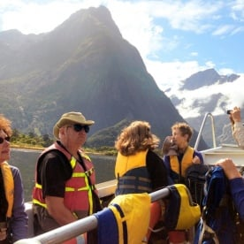 hikers cruising across milford sound to the milford track