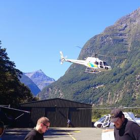 helicopter taking off from milford sound new zealand