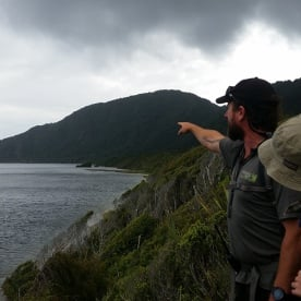 Guide and Hikers on the Fiordland Coast