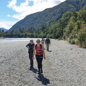 Walkers by the Hollyford River