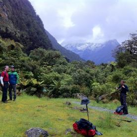 Milford Track walkers enjoying misty peaks