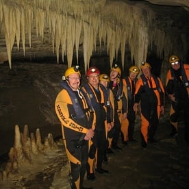 Caving Group and Stalactites in the Nile River Caves