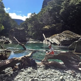 Walker resting by the Routeburn River