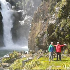 Walkers in front of Hidden Falls on the Hollyford Track