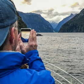 Taking picture from boat at Milford Sound, Fiordland National Park Southland New Zealand