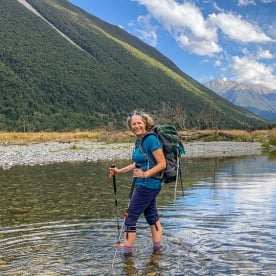 Guest crossing Travers river at Nelson Lakes National Park, Tasman New Zealand